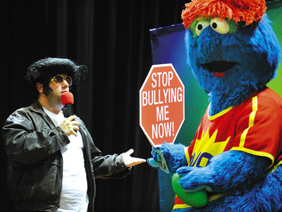 DAVE MUNCH/STAFF PHOTO Michael Harris, left, and Yojo perform during an anti-bullying assembly at Manchester Elementary Tuesday.